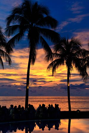 Diner on the beach at  a sunset photo