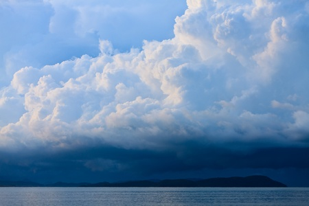Thunder storm with rain lit by the sun at a lake Stock Photo - 8243638