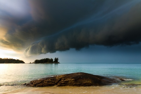 Thunder storm with roll cloud approaching the tropical beach Stock Photo - 8243572