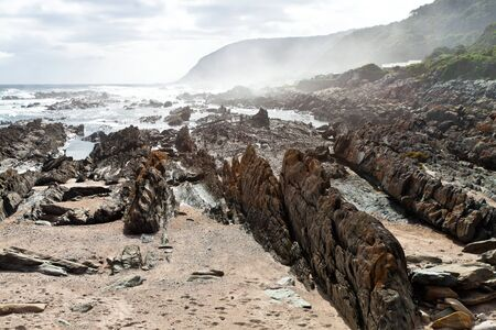 Beautiful dangerous rocky coastline of South Africa photo