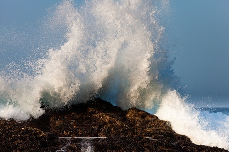 High wave breaking on the rocks of the coastline Stock Photo - 11409161