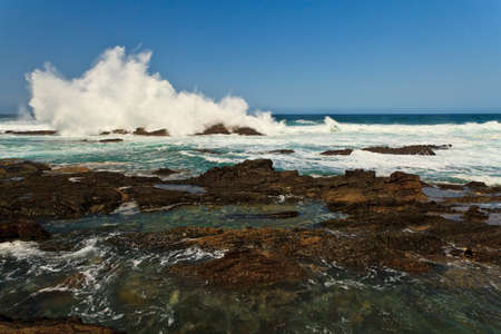 High wave breaking on the rocks of the coastline Stock Photo - 11409158