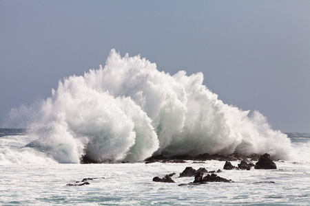 High wave breaking on the rocks of the coastline Stock Photo - 11409136