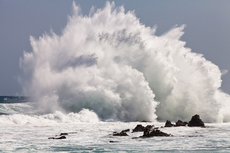 breaking up: High wave breaking on the rocks of the coastline Stock Photo