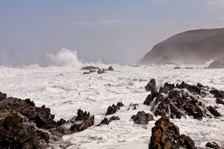 High wave breaking on the rocks of the coastline Stock Photo - 11409159