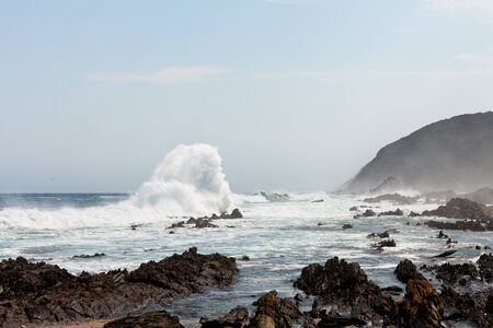 High wave breaking on the rocks of the coastline Stock Photo - 11409125