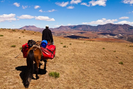 lonesome: Man riding on a horse in the mountains of africa