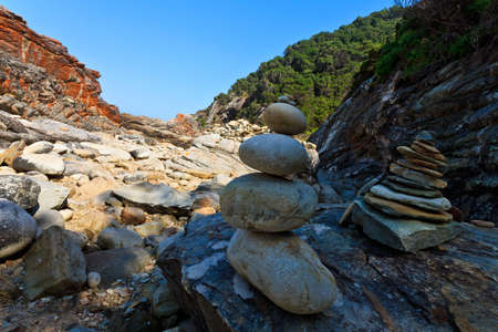 Pile of stones as trail  marking at the  rocky coastline of South Africa Stock Photo - 12577160