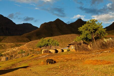 Village in the mountains  in beautiful evening light photo