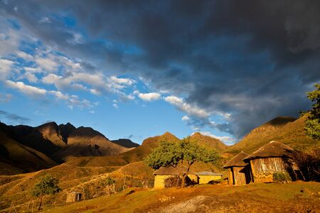 Primitive village in the mountains  in beautiful evening light photo