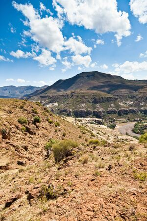 Rocky mountain landscape with dry riverbed on a sunny day photo