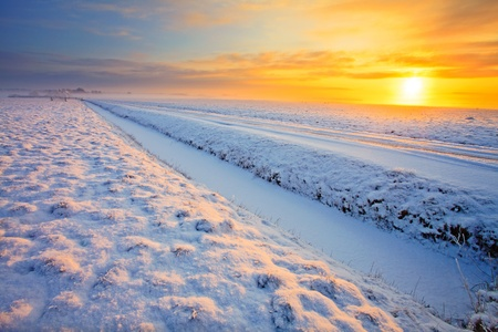 Grassland with ditch in winter at sunset Stock Photo - 13333821