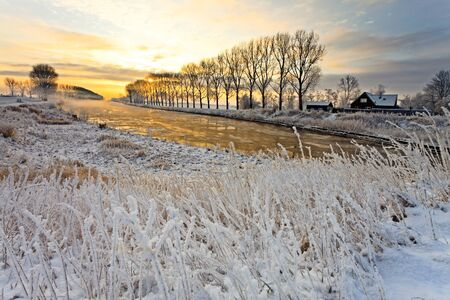 Canal in a cold white winter landscape photo