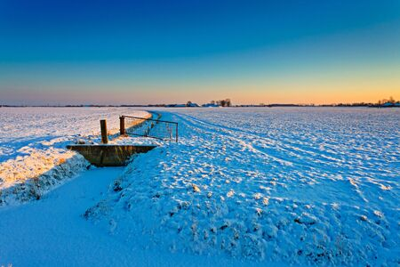 Sunset on a grassland in a cold white winter landscape Stock Photo - 13333810