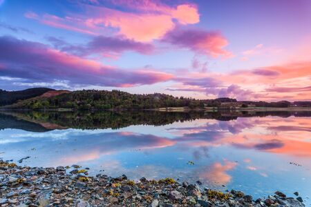 Colorful sunrise at a lake in Scotland photo