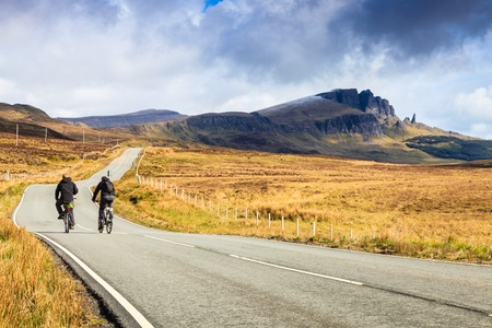 Bikers on a highway through a desolate landscape in Scotland photo