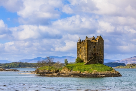 Medieval castle on a island in the water in Scotland photo