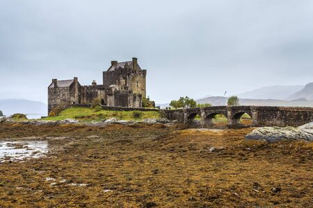 Eilan Donan castle at low water  in Scotland