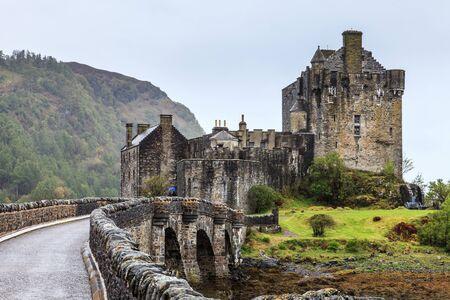 Bridge towards Eilan Donan castle in Scotland on a grey day