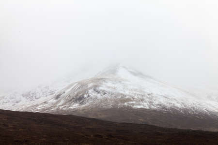 mistic: Mountain landscape  in the mist on a grey day Stock Photo