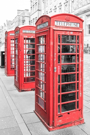 Row of traditional red phone booth in england photo