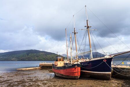 wheater: Boats in the harbour lying in the mud Stock Photo