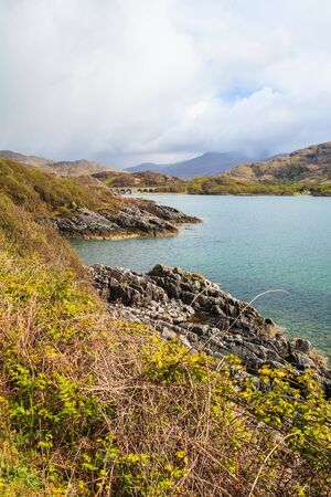 wheater: Rough lake landscape with dark clouds in the sky Stock Photo