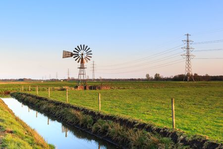 dutch typical: Water windmill in a typical dutch landscape