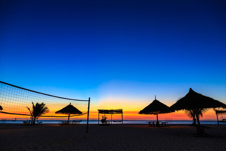 volleyball net: Sunset over the ocean at a tropical resort