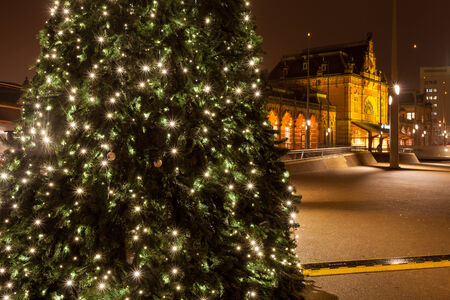 Christamas tree in city near the railway station in Groningen photo