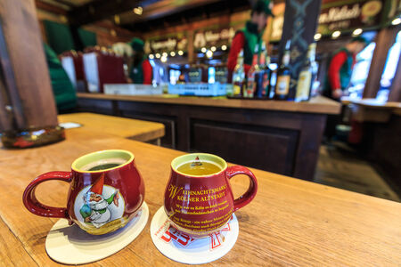 weihnachtsmarkt: Hot christmas wine, red and white, in a cup in Germany, Cologne