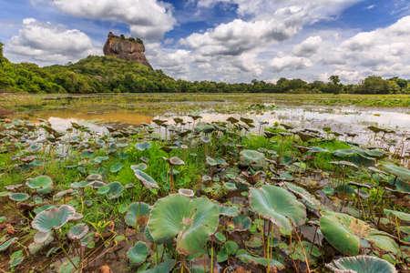 sigiriya: Landscape of lion rock and lake at Sigiriya in Sri Lanka Stock Photo