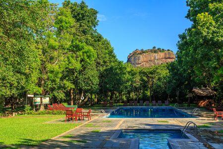 sigiriya: Resort with swimming pool near lion rock at Sigiriya in Sri Lanka Stock Photo