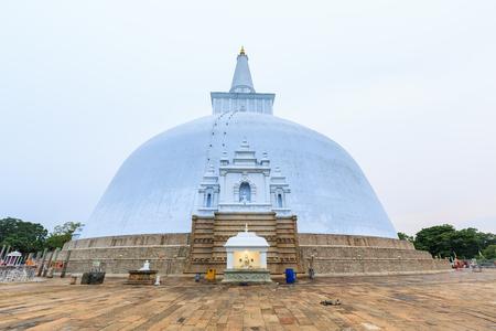 anuradhapura: Big buddhist stupa at Anuradhapura in Sri Lanka at sunset
