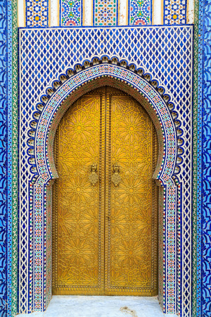 fes: Entrance door with mosiac and brass door at the Royal palace in Fes Morocco Stock Photo