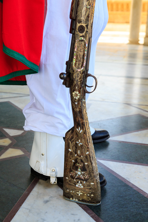 Beautiful rifle with mosaic of a guard at the Mausoleum of Mohammed V in Rabat, Morocco