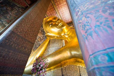 trone: Giant Buddha inside Wat Pho Temple bangkok Thailand.
