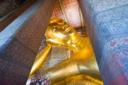 sutra: Giant Buddha inside Wat Pho Temple bangkok Thailand.