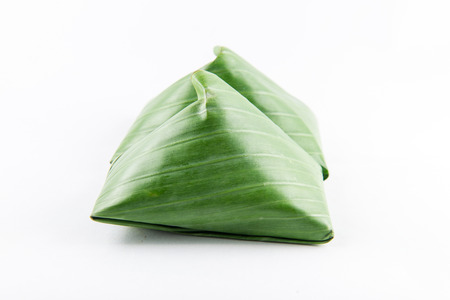 Thai dessert wrapped in banana leaves , cuisine