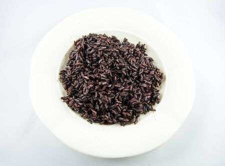 rice berry in white dish on white background