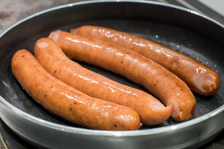 Sausages on a pan with induction