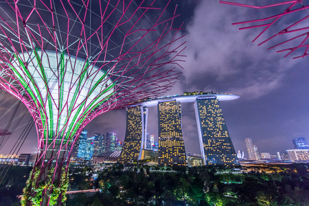 Marina Bay Sands hotel light show at night on May 22, 2015 in Singapore. It is the world's most expensive building with cost of US$ 4.7 billion and landmark of Singapore.