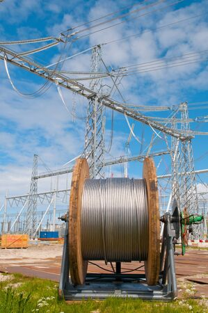 construction plant: cable reel in front of power line construction plant