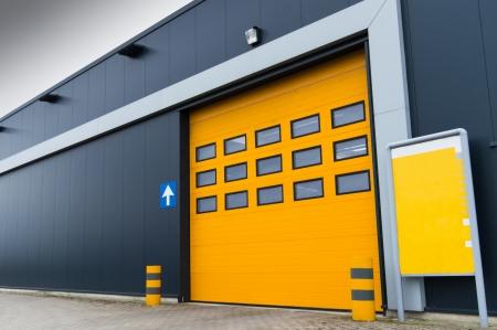 garage door: yellow loading door in a storage building