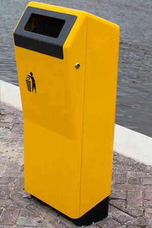 rubbish bin: new yellow bin for waste to throw in Stock Photo