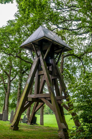 bell tower: Old bell tower in a cemetery in Netherlands