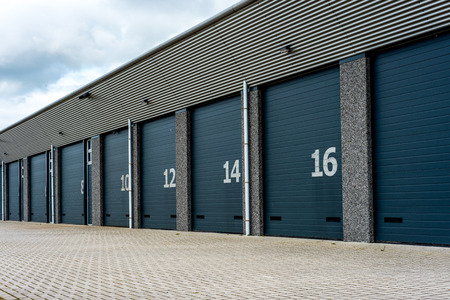 storage warehouse: Grey unit storage warehouse facility with numberd doord Stock Photo