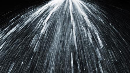 水黒背景を散水スプリンクラー 写真素材