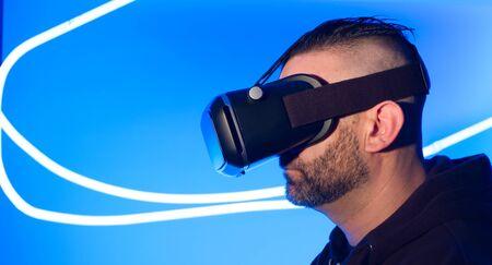 Man using VR virtual reality headset futuristic cyberspace Stock Photo