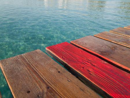 Playa de Muro wooden pier in Mediterranean Sea Stock Photo